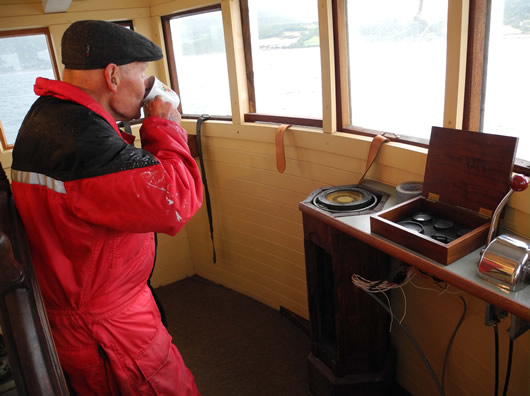 Mate Bjarne at the helm on the 2015 restoration voyage.